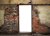 Empty doorway in old weathered brick wall — Stock Photo
