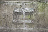 Rusted bracket steel details on old concrete wall — Stock Photo