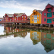 Red and yellow wooden houses in coastal Norwegian fishing village — Stock Photo #41088149