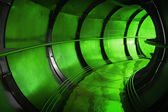 Abstract green underground industrial sewerage tunnel interior  — Stock Photo