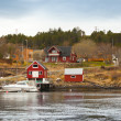 Traditional Norwegian fishing village with wooden houses on seac — Stock Photo