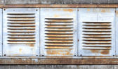 Background with old rusted metal ventilation grille panels  — Stock Photo