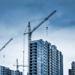 Tower cranes and modern buildings under construction — Stock Photo #41906847