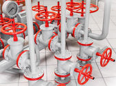 Group of red industrial valves on gray pipelines — Stock Photo