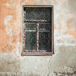 Old living house wall with closed window — Stock Photo