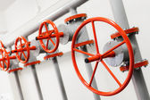 Group of red industrial valves on pipeline system — Stock Photo