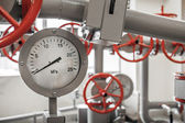 Valves and manometers on Industrial pipeline system — Stock Photo