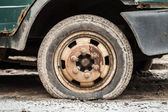 Rusted wheel of old car. Closeup photo — Stock Photo