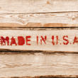 Made in USA. Red label on wooden box side — Stock Photo