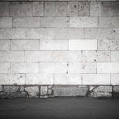 Square urban background texture with stone wall and asphalt — Stock Photo