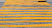 Pedestrian crossing road marking with yellow stripes on asphalt — Foto de Stock