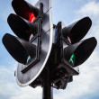 Red stop signal for cars and green pedestrian light on urban tra — Stock Photo #43666069