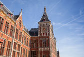 Old building facade of Amsterdam Centraal - central railroad station of the City — Stock Photo