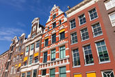 Colorful houses facades in sunny day above blue sky. Amsterdam — Foto de Stock