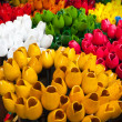 Traditional wooden colorful tulips in souvenir shop. Amsterdam — Stock Photo