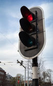 Red stop signal on black urban traffic light in Amsterdam — Stock Photo