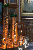 Candles are lit in a dark Orthodox Church — Photo