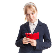 Portrait isolated on white. Blond Caucasian schoolgirl with mobile phone — Stock Photo