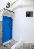Blue door and white walls. Medina, old part of Tangier, Morocco — Stock Photo