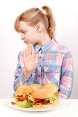 Little blond Caucasian girl saying hamburgers: No — Stock Photo