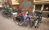 AMSTERDAM, NETHERLANDS - MARCH 19, 2014: Different bicycles stand on a parking place in Amsterdam — Stock Photo