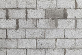 Gray wall made of aerated concrete blocks, background texture — Stock Photo