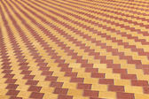 Background texture of red and yellow cobblestone pavement pattern — Stock Photo
