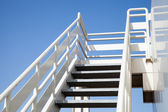 Perspective of white stairway to the captain bridge — Stockfoto