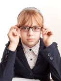 Little blond schoolgirl with glasses, closeup studio portrait — Stock Photo