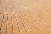 Background texture of urban yellow cobblestone pavement — 图库照片