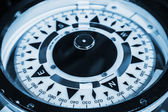 Naval compass. Blue toned monochrome macro photo — Stock Photo