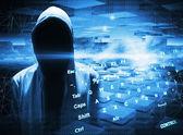 Hacker in a hood on dark blue digital background — Stock Photo