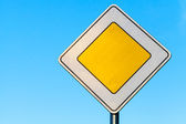 Main road yellow roadsign above clear blue sky background — Stock Photo