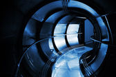 Abstract underground industrial sewerage. Dark blue metal tunnel — Stock Photo
