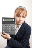 Little blond schoolgirl with calculator above white — Stock Photo