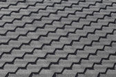 Modern black roof tiling pattern, background photo texture — Stock Photo