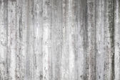 Gray concrete wall with wooden formwork pattern — Stock Photo