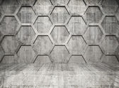 Abstract concrete interior with honeycomb structure on gray wall — Stok fotoğraf