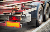 Back part with taillight of empty truck cargo trailer on asphalt — Stock Photo