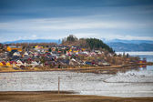 Norwegian village with colorful wooden houses on the sea coast — Stock Photo