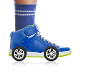 Blue Sport shoe with wheels isolated on white, speed concept — Stockfoto