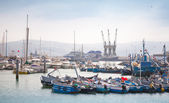 Fragment of Tangier port with small fishing boats and sailors at work — Stock Photo
