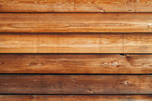 Old natural uncolored wooden wall surface. Background texture — Stock Photo
