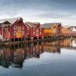 Red and yellow wooden houses in Norwegian village — Stock Photo #48939593