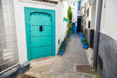 White walls and green door. Medina, old part of Tangier, Morocco — Stock Photo