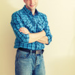Portrait of young Caucasian man in blue checkered shirt. Instagram toned effect — Stock Photo