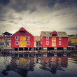 Red and yellow wooden houses in Norwegian fishing village — Stock Photo #49199845