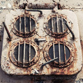 Old rusted emergency exit hatch on the deck of abandoned ship — Stock Photo