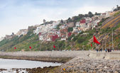 Coastal street panorama with flags, Tangier, Morocco — Stock Photo