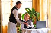 Waiter giving menu to female costumer at the restaurant — Stock Photo